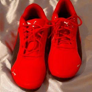 Stylish red Puma tennis shoes